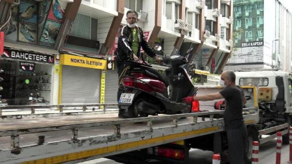 Sokağa çıkma kısıtlamasında motosiklet ile tur atarken yakalandı -1